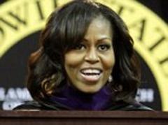 I can finally see! Michelle Obama debuts a new longer hairdo with 'irritating bangs' swept to the side