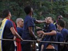 gerard pique and alex song fight on top of barcelona bus parade